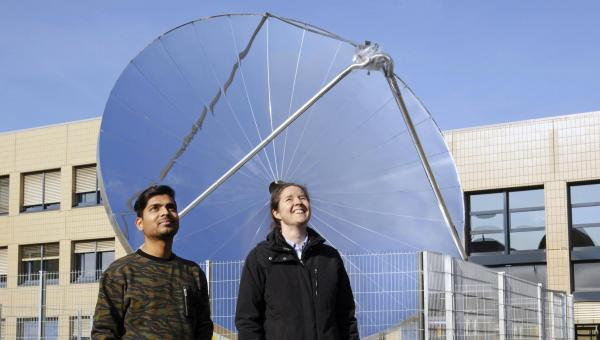 SOHHYtec co-founders in front of the prototype on EPFL campus